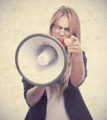 Young cool woman ordering at megaphone — Stock Photo