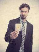 Young crazy businessman with an ace — Stock Photo