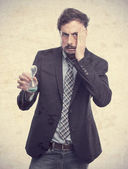 Young crazy businessman worried about time — Stock Photo