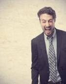 Young crazy businessman shouting — Stock Photo