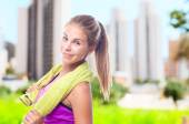 Young cool woman with a towel — Stock Photo