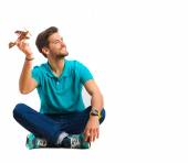 Guy playing with wood plane — Stock Photo