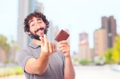 Young crazy man money gesture — Stock Photo