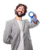 Young crazy man with a medal — Stock Photo
