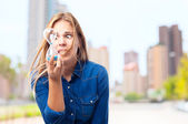 Young cool woman with a timer, worried — Stock Photo