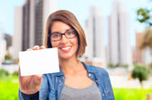 Young cool woman with name card — Stock Photo