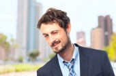 Young crazy businessman wink gesture — Stock Photo