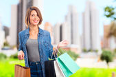 Young cool woman with shopping bags — Foto de Stock