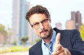 Young crazy businessman pointing — Stock Photo
