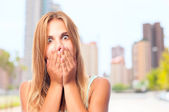 Young cool woman covering her mouth — Stock Photo