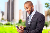 Young cool black man with touch screen phone — Foto de Stock