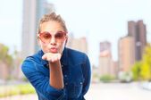 Young cool woman sending a kiss — Stock Photo