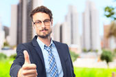 Young crazy businessman all right gesture — Stock Photo