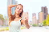 Young cool woman victory sign — Stock Photo