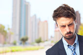 Young crazy businessman angry face — Stock Photo