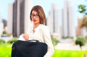 Young cool woman with a suit case — Stock Photo