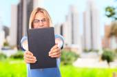 Young cool woman with a book — Stock Photo