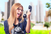 Young cool woman shouting at phone — Stock Photo