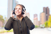 Young cool woman with headphones — Stock Photo