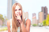 Young cool woman silence sign — Stock Photo