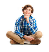 Teenager sitting thinking — Stock Photo