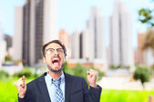Young crazy businessman celebrating gesture — Stock Photo
