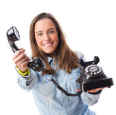 Young woman holding a telephone — Stock Photo