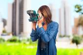 Young cool woman with a camera — Stock Photo