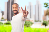 Young cool black man victory sign — Stock Photo