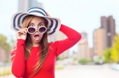 Young cool woman with sunglasses and a hut. surprised concept — Stock Photo