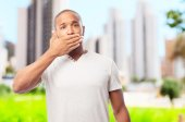 Young cool black man covering his mouth — Stock Photo