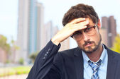 Young crazy businessman worried gesture — Stock Photo