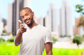 Young cool black man shoot sign — Stock Photo