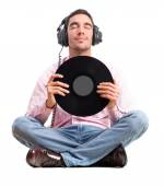 Man with headphones and vinyl — Stock Photo