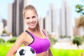 Young cool woman with football ball — Stock Photo