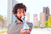 Young crazy man worried with a timer — Stock Photo