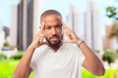 Young cool black man thinking — Stock Photo