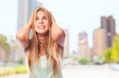 Young cool woman with head pain — Stock Photo