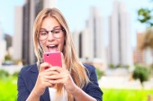 Young cool woman with touch screen phone — Foto de Stock