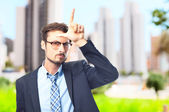 Young crazy businessman loser gesture — Foto de Stock