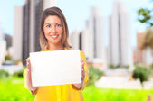 Young cool woman with a placard — Stock Photo