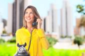 Young cool woman speaking on phone — Stock Photo