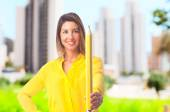Young cool woman with a pencil — Stock Photo
