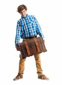 Teenager holding a trunk — Stock Photo