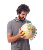 Young bearded man with world globe — Stock Photo