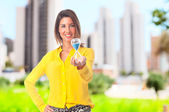 Young cool woman with a timer — Stok fotoğraf