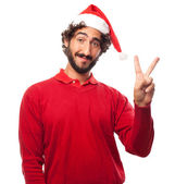Young man victory gesture — Stock Photo