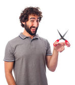 Young bearded man with scissors — Stock Photo