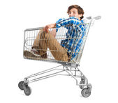 Teenager inside a shopping cart — Stock Photo