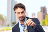 Young crazy businessman with a bell — Stock Photo